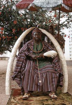 Africa |Oba Olateru Olagbegi II, the Olowo of Owo, seated beneath carved ivory tusks, Owo, Nigeria. |©Eliot Elisofon. 1959.