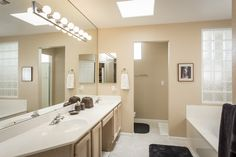 The master bathroom is full of luxurious features.