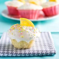 Lemon Cupcakes with Lemon Cream Cheese Frosting on MyRecipeMagic.com  A tender, moist lemon cupcake topped with a light and tangy lemon cream cheese frosting.