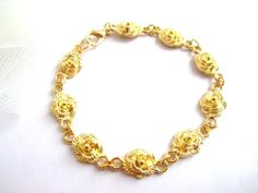 Tiny gold flower bracelet simple gold charm by MalinaCapricciosa, $16.00