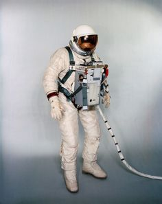 Suited test subject equipped with Gemini 12 Life Support System and waist tethers for extravehicular activity.