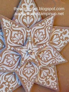 Stampin' Up! ... handmade Christmas card from the crafty yogi: Winter Holidays ... close up of layered star from Bright and Beautiful bundle ... white embossing on kraft ... reminds me of iced gingerbread cookies ...