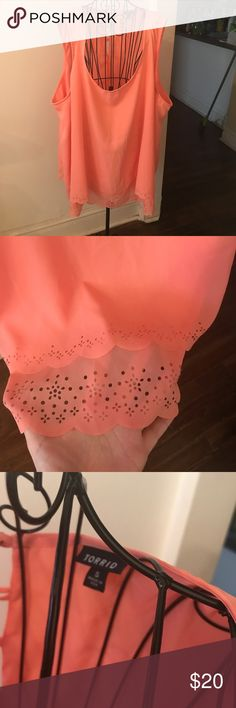 Torrid coral sleeveless blouse size 5 New without tags. Coral sleeveless half button up back, with perforated trim. I'm motivated to sell, so make me an offer! This is a Torrid size 5 (please see the included size chart ✅). torrid Tops Blouses