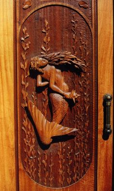 """Hand-carved Honduran mahogany mermaid front door. 4"""" thick with 3"""" relief to the carving.  Lefner Sculpture."""