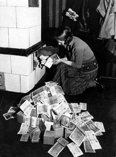 Burning money during the inflation crisis in Germany, 1920. Paper money was cheaper than coal and wood.