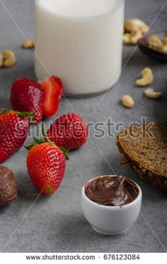 chocolate spread with wholegrain bread, fresh strawberries