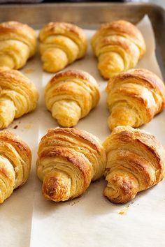 These Homemade Crescent Rolls will become a staple at your dinner table. They are easy to make, flaky, tender, and take much less time to make thancroissants! Plus, they aren't as hard or as labor intensive as one might think! They are the perfect side dish recipe to your holiday dinners. #crescentrolls #sidedish