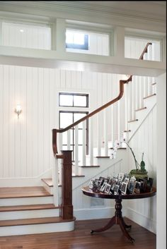 Check out this stairway. Wow, I like the window on the back wall. I think the beadboard looks beachy and I love the transoms that makes the stairway into a separate room, but lets light in at the same time. White Wood Paneling, Paneling Walls, Painting Paneling, Tongue And Groove Panelling, Transom Windows, Dormer Windows, Wood Windows, Small Windows, Wood Panel Walls
