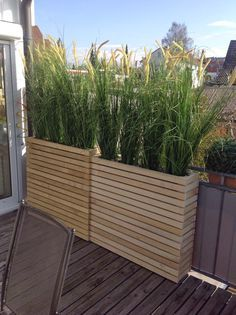 DIY planters, planter ideas, skinny planters for grasses, give it height, planters used as screens.