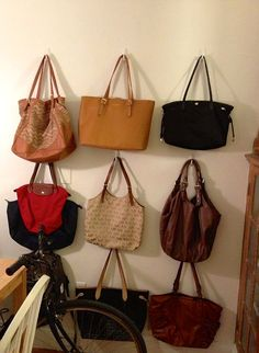 Purses hung on the wall with command hooks – Purses And Gandbags Organization Backpack Storage, Handbag Storage, Handbag Organization, Organizing Purses, Hanging Purses, Organizar Closet, Dinosaur Fabric, Kids Purse, Boutique Decor
