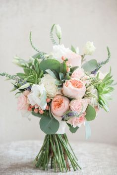 White, peach and lots of greenery in this lovely spring bouquet with Juliet roses.