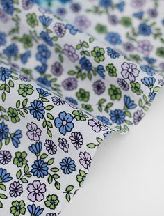 Waterproof Fabric Mini Flowers  Blue  By the Yard by landofoh, $9.50 -- lining for diaper bag? Too girly?
