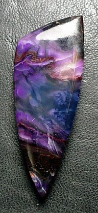 sugilite/richterite . This crystal is said to be the crystal of Archangel Michael. That is why I am pinning this here.
