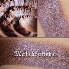 MALEBRANCHE – Aromaleigh Cosmetics Malebranche is a rich midtone copperish brown with slight metallic effects, and overlaid with a pale blue to silver duochrome effect. In different lighting, the duochrome can appear to blend with the base color, giving this shade a purplish lean.