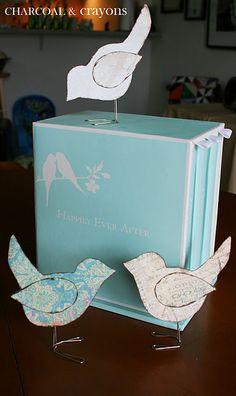 Scrappy little birds made from scrapbook paper, paper clips and hot glue.  Cute!