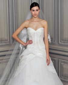 New wedding dresses by Monique Lhuillier from the designer's Spring 2012 bridal runway collection.
