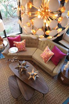 Sputnik style chandelier and angled sofa by Jonathan Adler have a cool retro vibe!