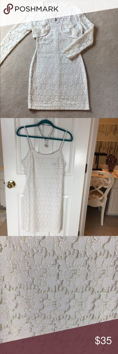 Evening dress with jacket Sexy and delicate white lace Sheath dress with matching jacket. Fully lined dress jacket is not lined. The dark area on the second photo is only the tag color showing through. It is not a stain. Measurements from shoulder to hem is 37 inches long & across the bust is 16 inches. The material is stretchy, so it does have some give and hugs the figure nicely. Only worn a couple of times on vacation, in excellent condition. Zippered back. Pet free smoke free home. Fast…