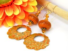 Dress up your look with these orange dangle earrings. Many times the accessories make the outfit and I think these handcrafted earrings will