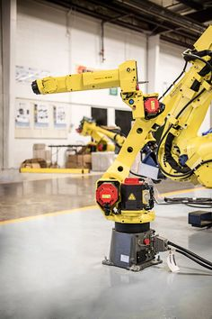 FANUC robots are available at RobotWorx for great prices! See more information here on the robot. Industrial Robotic Arm, Robot Arm, Robots, Stationary, Weapons, Tech, Study, Weapons Guns, Guns