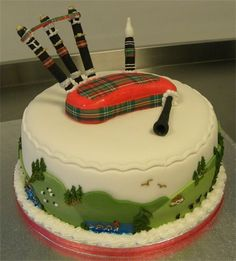 A Scottish themed Bagpipe cake.  Bagpipe cake with Scottish themes and images.