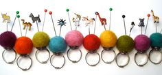 Vintage stickpins/pins in felted ball pincushion rings.