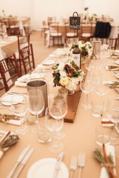 Rustic, winter wedding tables - wooden plank centrepiece!