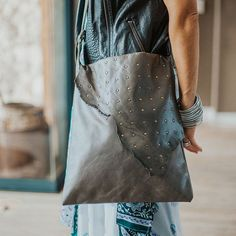 the oversized 'lau' flap bagin a limited edition grey leatherwith stud details