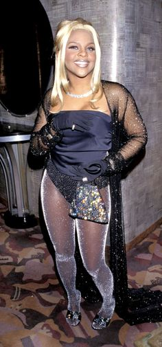 Lil Kim from Riskiest Looks Ever at the Grammy Awards As if the fact that she was missing pants wasn't enough to turn heads, the rapper upped thetacky factor on her 1998 Grammys look by covering everything from her tights to her purse in sparkles. Grammy Fashion, 2000s Fashion, Hip Hop Fashion, Fashion Photo, Fashion Outfits, Jennifer Lopez, Grace Jones, Olivia Newton John, Dolly Parton