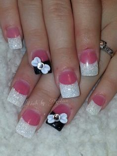 Pink & white nails with a touch of black... 3d bows