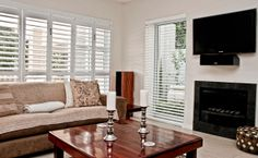 Light, airy lounge shutters Wood Shutters, Blinds, Lounge, Curtains, Home Decor, Airport Lounge, Wood Blinds, Drawing Rooms, Decoration Home