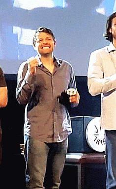 Misha watching Sebastian throw candy at fans