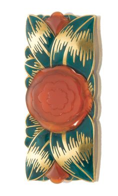 CARNELIAN AND ENAMEL BROOCH, RAYMOND TEMPLIER, 1921 The plaque with floral carved carnelian and leaves decorated with green enamel, signed Raymond Templier.