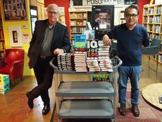 L to R: John Sandford, Joe Ide, and just a few of the books they had to sign.