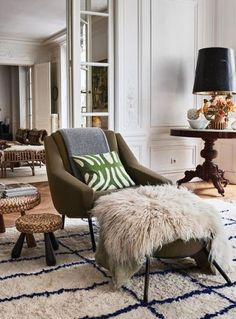 At home with the creative director of French fashion house Chloé : A '50s chair by Carlo di Carli, one of a large collection of chairs that scattered throughout the house. The designer says she just can't stop herself from buying them.