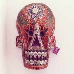 XXX grande wooden skull with milagros!