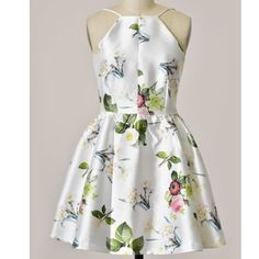 Floral Fit and Flare Dress Tank top floral mini dress. 100% polyester. Hidden back zipper. Exposed back. Available in small, medium, large Dresses Mini