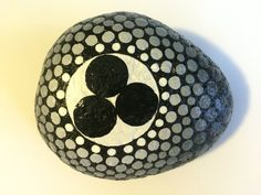 Medium black and white hand painted stone with by MadeleineMagill...Ancient symbol for peace!