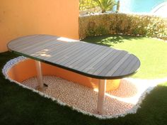 Table de jardin ; Réalisation Menuiserie Minier Golfe de St-Tropez.