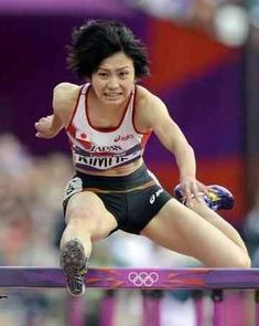 女子100メートル障害予選に出場した木村文子=五輪スタジアム(共同)