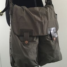 Celine military style saddle bag Celine military style saddle bag. Deep inside pocket and 2 front pockets. Side zippers open to secret compartments. Adjustable strap. Some very slight wear on bottom otherwise this purse is in perfect condition. Authentic Celine Bags Crossbody Bags