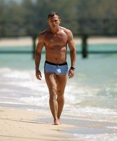 Daniel Craig as James Bond wearing a Grigioperla Swim Suit