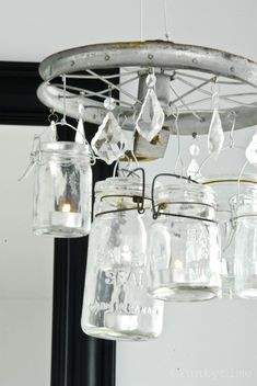 Old Pulley or new one (can be purchased at any hardware store, I would spray paint it in a dark rusty finish)  Magnetic Crystals  Tealights  Mason Jars  Craft Silver Wire  2 hooks (to attach to ceiling)
