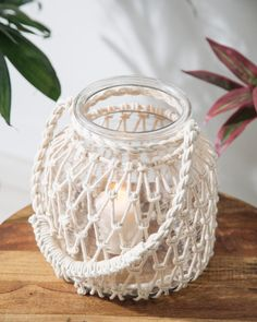 Formentera Macramé Glass Lantern Treat your interior decor to a warm inviting glow with our Macrame Collection of cylinders and lanterns. A unique way to display your flowers, candles or seashells. Shop INDOCHINE MAISON & Begin the adventure. Macrame Design, Macrame Art, Macrame Projects, Macrame Knots, Crochet Jar Covers, Ideias Diy, Diy Candles, Candle Wax, Design Candles