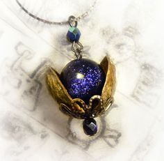 Universe in a nutshell pendant made with real pistachio shells and blue sandstone on Wanelo