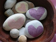 Love rocks. Tissue paper hearts coated in PVA glue to form a seal. So simple but look great!