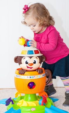 The Bright Starts Hide 'N Spin Monkey teaches cause and effect through interactive play