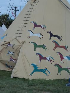 Stylized horses adorn this Native American Teepee adjacent to the rodeo grounds at the Pendleton Roundup (7)