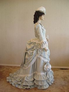 1870s -- back when the distinction between your dress and the drapes was harder to draw...