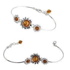 Triple sunflowers sterling silver bangle set with honey Baltic amber. The bangle includes an extender to enable a perfect fit for all wrist sizes.